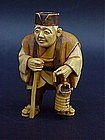 Japanese Ivory Netsuke Man with lantern artist signed