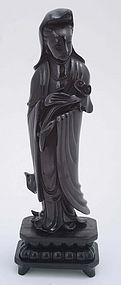 Chinese Dark Cherry Amber Carved Guanyin Buddha