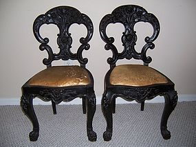 A Good Pair of Carved Black Walnut Chairs, 19th century