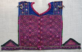 A child's embroidered dress front from Afghanistan