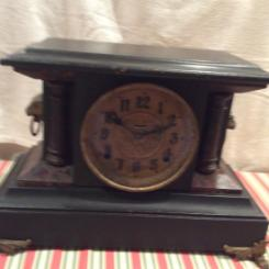 E. Ingraham mantel clock , dates back to 19th C. In working condition with beautif  chimes.