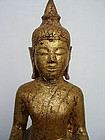 Antique Gilt Wooden Buddha on high stepped Throne