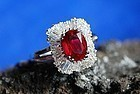 EXCEPTIONAL PIGEON BLOOD OVAL RUBY AND BAGUETTE DIAMOND RING