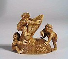 Japanese Ivory Okimono, Three Oni on Hat, Meiji