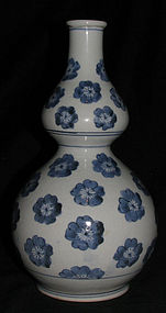 A Japanese Arita blue and white double gourd vase.