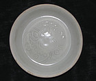 A Qingbai saucer with carved floral decoration.