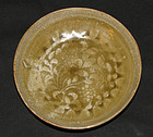 A celadon floral decorated molded dish. Song dynasty.