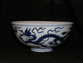 A blue and white dragon bowl. Jiaqing mark and period.