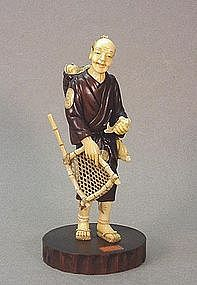 JAPANESE WOOD & WALRUS CARVING OF A FISHERMAN