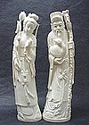 A PAIR OF CHINESE CARVED IVORY STATUES
