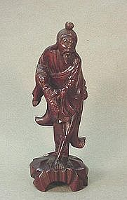 CHINESE CARVED WOOD STATUE OF A FISHERMAN