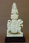 CHINESE CARVED IVORY BUDDHA WITH LION