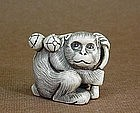 JAPANESE CARVED IVORY NETSUKE OF A MONKEY
