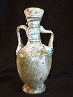 A SMALL ROMAN GLASS AMPHORA