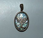A ROMAN GLASS FRAGMENT SET IN MODERN SILVER PENDANT