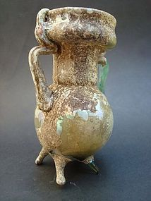 A ROMAN PALE GREEN GLASS SPRINKLER ON THREE FEET