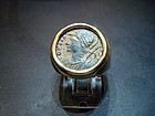 A ROMAN BRONZE FOLLIS OF CONSTANTINE THE GREAT IN RING