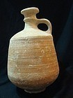 AN ISRAELITE TERRACOTTA DECANTER