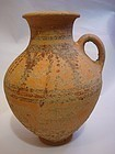 A CANAANITE BICHROME SINGLE HANDLE AMPHORA
