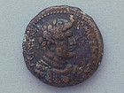 A ROMAN PROVINCIAL BRONZE COIN OF DOMITIAN