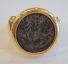 A BRONZE PRUTAH OF HEROD AGRIPPA I IN A 14K GOLD RING