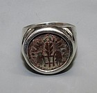 A BRONZE PRUTAH OF PONTIUS PILATE WITH SIMPULUM IN SILVER RING