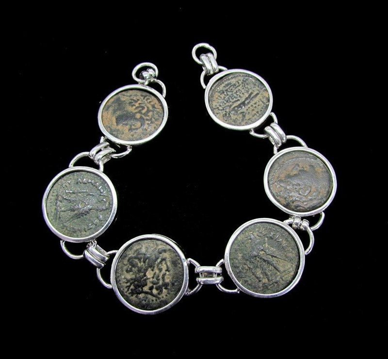 SIX BRONZE COINS OF THE PTOLEMIES AND SELEUCIDS IN SILVER BRACELET