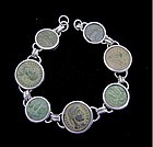 SEVEN JEWISH AND CHRISTIAN BRONZE COINS  IN SILVER BRACELET