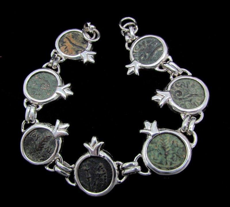 SEVEN PRUTOT FROM ROMAN JUDAEA IN SILVER POMEGRANATE BRACELET