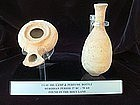 A HERODIAN TERRACOTTA OIL LAMP AND ALABASTRON