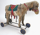 Steiff donkey riding pull toy with button