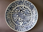A rare, large  Ming Dynasty blue and white Peacock dish