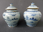 A rare pair of early Ming blue and white jars with lid