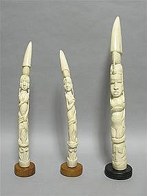 THREE AFRICAN IVORY TUSKS DEPICTING STANDING LADIES