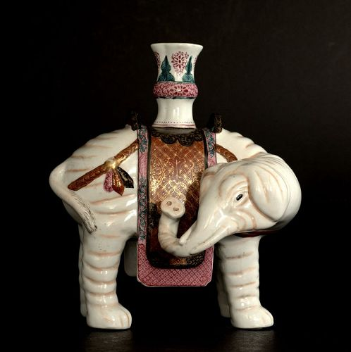 A Chinese Porcelain Elephant with a Vase on Its Back, Qing