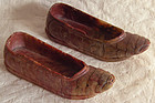 Antique small pair of carved stone shoes