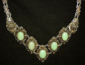 Ornate silver filigree necklace with stones