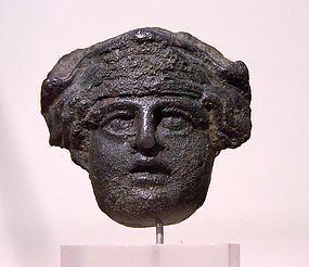 AN ANCIENT ROMAN APPLIQUE OF DIONYSUS
