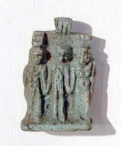 AN ANCIENT EGYPTIAN FAIENCE TRIAD AMULET