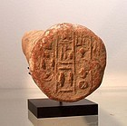 AN ANCIENT EGYPTIAN TERRACOTTA FUNERARY CONE