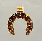 AN ANCIENT ROMAN GOLD AND GLASS PENDANT