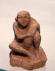 AN ANCIENT EGYPTIAN EROTIC WOOD FIGURE OF A MAN