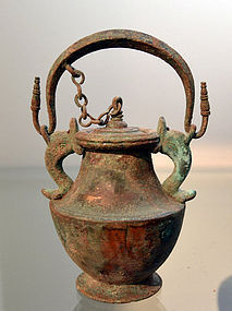 A HELLENISTIC BRONZE LIDDED VESSEL