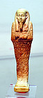 A FINE ANCIENT EGYPTIAN FAIENCE USHABTI