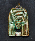 AN ANCIENT EGYPTIAN FAIENCE HATHOR AMULET