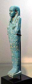 AN ANCIENT EGYPTIAN FAIENCE SHABTI FOR ANKH-EM-MAAT