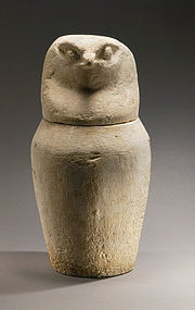AN ANCIENT EGYPTIAN LIMESTONE CANOPIC JAR