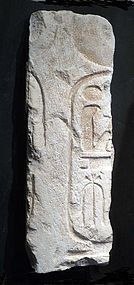 AN EGYPTIAN LIMESTONE CARTOUCHE FOR RAMSES II