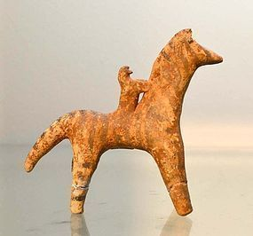 A BOEOTIAN TERRACOTTA HORSE AND RIDER
