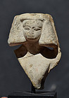 AN EGYPTIAN MIDDLE KINGDOM FEMALE STONE BUST